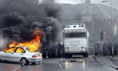 A car burns after Nationalist rioters clashed with Police Service of Ireland in the Ardoyne area of North Belfast, Northern Ireland.  (AP)