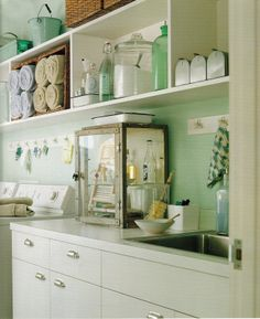 Love the mini mailboxes and glass bottles and vintage medicine cabinet!