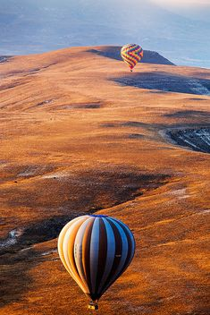 """Cappadocian Dream"" ~~ Balloons fly over the surreal landscape of Goreme park in Cappadocia, Turkey during a perfect summer morning. by John & Tina Reid, via Flickr"