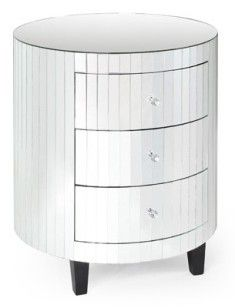 A very detailed piece of mirror furniture with thin paneled mirrors, and three drawers accented with glass knobs.