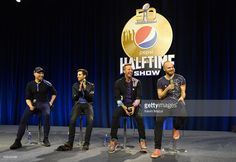 Musicians Jonny Buckland, Guy Berryman, Chris Martin and Will Champion of Coldplay speak onstage at the Pepsi Super Bowl Halftime Press Conference on February 4, 2016 in San Francisco, California.
