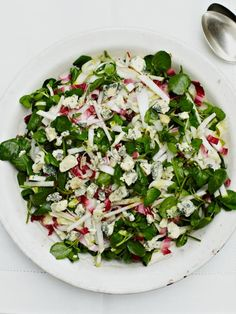 150 g watercress - 2 heads of chicory, different colours if possible - 1 lemon - 2 tablespoons extra virgin olive oil - sea salt - freshly ground black pepper 1 firm pear - 40 g blue cheese, such as Stilton or Cashel Blue