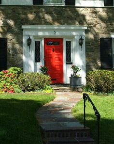 Red front door with white sidelights