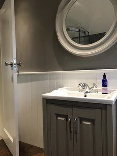 A traditional vanity unit and period basin tap add style and sophistication to this traditional bathroom design.
