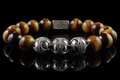 Check the way to make a special photo charms, and add it into your Pandora bracelets. Designer Beaded Bracelet for men made with 12mm .925 sterling silver beads and 12mm yellow brown Tiger Eye stones, part of our premium silver collection
