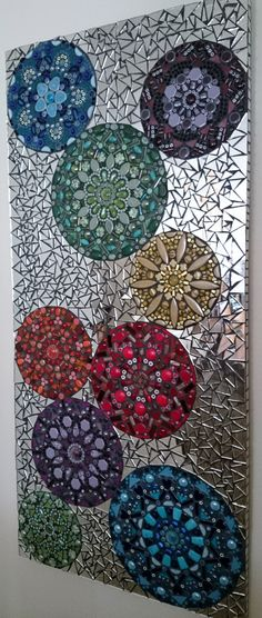 "Kaleidoscope Mosaic | Nichole Aubrey Mosaics Using the direct method with an MDF substrate, tesserae materials include: Jasper, Lapis lazuli, Carnelian, Italian Murano Millefiori, Ceramic tile, Beads, Mirror, Glass rods and gems Measurements: 45"" Tall x 21"" Wide 32 lbs"