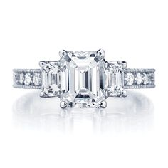 Three stone emerald cut diamond engagement ring with channel set band featuring milgrain engraving detail. Ingwer at George Simons & Son. Engagement Ring Images, Three Stone Engagement Rings, Designer Engagement Rings, Natural Blue Diamond, Emerald Cut Diamond Engagement Ring, Bridal Jewelry Sets, Ring Verlobung, Unique Rings, White Gold Rings