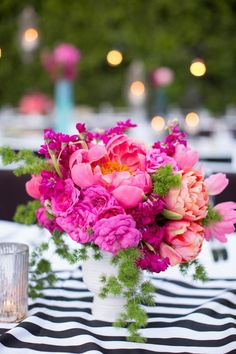Bright florals with black and white table runners.