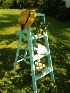 Old wood ladder painted turquoise Old Wood Ladder, Unwanted Furniture, Garden Art, Garden Ideas, Unique Gardens, Hand Painted Furniture, Coastal Living, Outdoor Gardens, Ladder Decor
