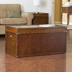 Love the idea of a steamer trunk as a coffee table