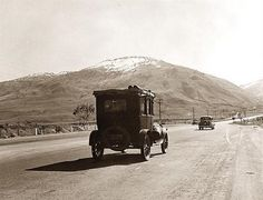 : California 1939, a car full of migrant  workers on their way to work in the San Joaquin Valley, us 99, Kern co.
