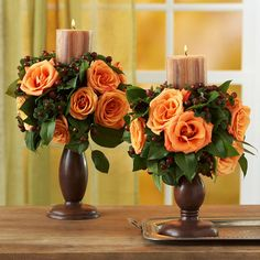 Simple wood candleholders become centerpieceworthy when dressed up with roses and greenery: http://www.bhg.com/halloween/decorating/creative-fall-centerpieces-featuring-natural-elements/?socsrc=bhgpin092214rosecandleholders&page=29