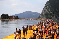 "Iseo, Italy, Thousands of people stepped out onto artist Christo Vladimirov Javacheff's latest work in northern Italy on Saturday, seizing the chance to ""walk on water"" until bad weather forced the evacuation of the floating walkway. Land Art, Christo Floating Piers, Christo Et Jeanne Claude, Christo Art, Vivre A New York, Italian Lakes, Walk On Water, Reportage Photo, Venice Biennale"