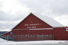 Red aircraft building in snow. Learn more about printing your high quality photography at http://prolabdigital.com !