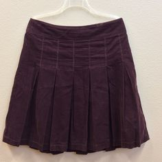 American Eagle pleated corduroy skirt size 10. Cute a-line maroon pleated corduroy American Eagle skirt. Worn 3-4 times, EUC. Size zip. American Eagle Outfitters Skirts A-Line or Full