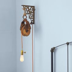 Barn Pulley Wall-Mount Light Fixture Photo: Ryan Benyi | thisoldhouse.com | from 23 of Our Best Salvage-Style Projects