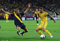 Getting the block in: Olof Mellberg----Sweden, prevents Shevchenko from getting his shot away