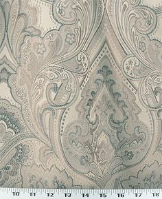 Medium Weight Drapery / Medium Weight Upholstery This large-scale floral woven fabric is a beautiful jacquard in shimmery beige accented with midnight blue and brown.