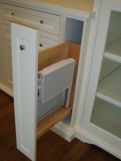 Folding Step Stool Connected To The Cabinet Door Pulls