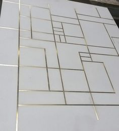 Brass inlay in tiles. Concrete by LCDA