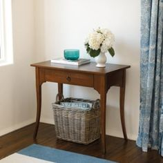 Contessa Side Table | Ballard Designs.  This would be narrow enough for either side of the door from the hallway.