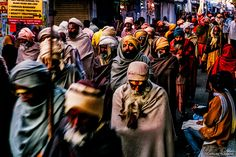 A group of 'sadhus' (Hindu holy men) rushes through the streets of Pushkar during the build up to Kartik Poornima, the religious festivity that concludes the annual Pushkar Fair, in Rajasthan, India