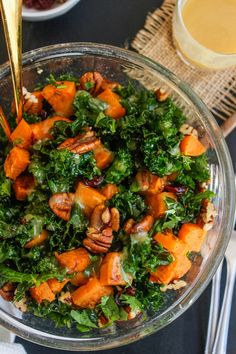 Spicy roasted sweet potato & kale salad with a maple tahini dressing topped with pecans and dried cranberries @asaucykitchen