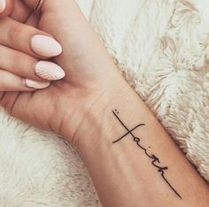 A cross-like elegant quote wrist tattoo