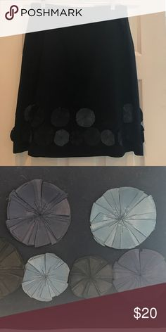 A-line skirt with silk flower detail Navy a-line skirt, fully lined. 100% cotton. Silk flower detail in blue-gray, navy, and black Boden Skirts A-Line or Full