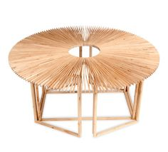 Fan Table by Mauricio Affonso   Curitiba, Brazil   - A table that can quickly transform into an array of different shapes, and sizes, to suit context or use.