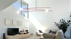 Still Light /   By Feld /   This lamp-cum-mobile floats in space like a Calder sculpture. Each is fully adjustable.