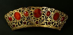 Antique Back Comb, Czech Republic (19th c.; Bohemian carnelians, golden brass, horn). Now in the Czechoslovakian Ethnographical Museum, Prague.