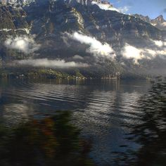 Switzerland...from the train window. It's a series of picture post cards strung together. Photo: Nitin Gopal Srivastava #Switzerland #nature #beauty #landscape #ig_Switzerland #Swiss #ignation #naturelovers #igs #iger #igers #ig_captures #river #mountain #sky #train #view #igdaily #instalike #instapic #insta #instanature