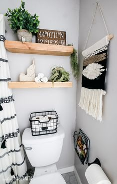 You're going to love this bathroom decor on these floating shelves over toilet that have a fun boho style, but still fit in with the modern farmhouse theme! Perfect for some extra storage for towels and other things in a small bathroom. I love the wire basket on the back of the toilet to hold toilet paper. #boho #bathrooms #smallbathroom #bohostyle #bathroom