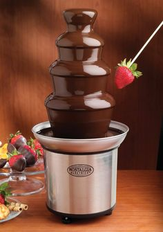 NOSTALGIA ELECTRICS 3-Tier Stainless Steel Chocolate Fountain $28.95 TOTAL PRICE...LOWEST PRICE GUARANTEE...PICK UP OR WE WILL SHIP FREE WORLDWIDE...100% MONEY BACK SATISFACTION GUARANTEED...WEBSITE: www.shopculinart.com