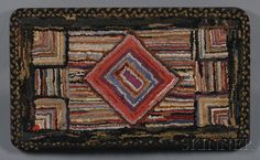 AMERICAN FURNITURE & DECORATIVE ARTS - SALE 2585B - LOT 542 - GEOMETRIC HOOKED WOOL RUG WITH BRAIDED BORDER, AMERICA, LATE 19TH/EARLY 20TH CENTURY, MOUNTED ON A WOOD FRAME, 24 X 40 IN. PROVENANCE: - Skinner Inc