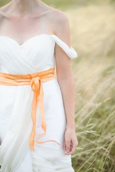 Tied with a ribbon: http://www.stylemepretty.com/2015/09/01/make-a-statement-with-bold-bridal-accessories/