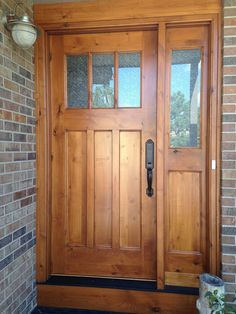 Another version of the Craftsman style - this one built of knotty alder with flat panels and single sidelight. Delta Frost glass provides privacy, yet visually lightens the interior entry.