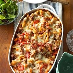 Italian Pasta Bake Recipe -I love to make this dish whenever I need to bring a dish to pass. Fresh tomatoes add a nice touch that's missing from most other meat, pasta and tomato casseroles.—Karla Johnson, East Helena, Montana