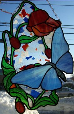Stained glass butterfly and flower panel