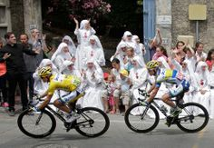 Race leader yellow jersey holder Orica Greenedge team rider Simon Gerrans of Australia cycles past Sisters of the Consolation congregation during the 228.5 km fifth stage of the centenary Tour de France cycling race from Cagnes-Sur-Mer to Marseille on July 3. (Jacky Naegelen/Reuters) #