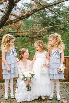 A timeless long sleeved lace wedding dress and icy bluy flower girls for a classic winter wedding in January | fabmood.com #winterwedding #longsleevedweddingdress