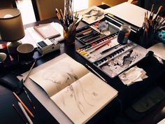 Drawing on moleskine on a table full of stuff!