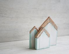 Hand Painted Wooden Houses Ornaments Copper Mint set of 3 Rustic. $19.90, via Etsy.