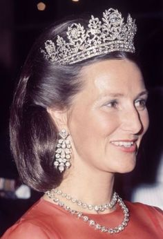 Queen Sonja of Norway, with Josephine's diamond tiara, diamond earrings wich once belonged to Queen Victoria, and two diamond collet necklaces. 1974.