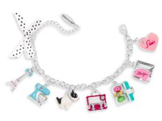 """Grace's Bracelet for Girls - This Grace-inspired bracelet for girls features eight charms: a polka-dot ribbon bow, an Eiffel Tower, a stand mixer with a bowl that spins, a French bulldog with a rhinestone collar, a suitcase that opens, a pastry box that opens to reveal three macarons, a metal envelope that opens and has a letter inside, and a rhinestone heart with """"Paris"""" in red."""