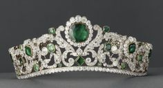 """DUCHESSE d'ANGOULÊME EMERALD AND DIAMOND TIARA    Exceptionally rare as it survived the French Revolution, Restoration and both installations of the Empire. The tiara was commissioned by the duc d'Angoulême, made by the Brothers Bapst, who created this """"masterpiece of early 19th jewelry"""". The tiara actually curves up in the center to fit the contour of the wearer's head. A tiara with ergonomics. Lavish.     It is now in the Louvre Museum in Paris."""