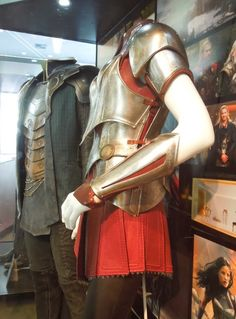 Sif costume, on display. Shows the layered breastplate, buckles on the side. Closer view of the bracer, showing more scrolled etching and rolled edges. Possible to see here the separation between the underdress and the Queen Anne-style collar.