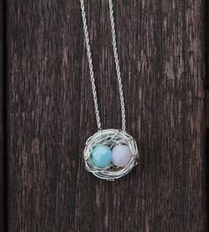 Bird Nest Necklace | Two bright beads adorn this lovely wire nest necklace.