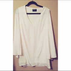 Nasty gal white flowy dress Worn once to a date party! Fun and comfortable white dress. Nasty Gal Dresses Long Sleeve